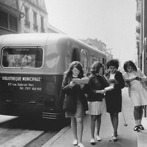 """Just reading """"Mobile library in Levallois France, 1960. Photo: Gérald Bloncourt."""""""
