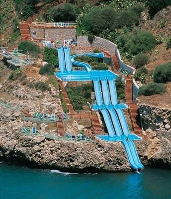 Citta del Mare Hotel in Italy.... basically the coolest thing ever, a waterslide that drops you right into the mediterranean!!