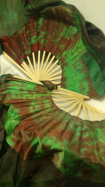 Fairy Cove Silks - ORDERABLE:  Standard Long Fan Pair in MAGICAL FOREST and 12mm TEXTURED GREEN SATIN  HAND, $140.00 (http://www.fairycove.com/orderable-standard-long-fan-pair-in-magical-forest-and-12mm-textured-green-satin-hand/)