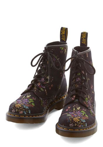Keep on being your fabulous self, grounding ensemble after ensemble in these floral boots from Dr. Martens! Sturdy black canvas boast a jewel-tone floral print for casual looks that are both laid-back and enduring!