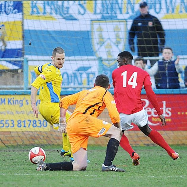 Chorley sub Darren Stephenson scored the opening goal, despite the best attempts of Alex Street and Ryan Clarke, yellow. Picture: Ian Burt  King's Lynn Town FC #kltfc  8/02/14