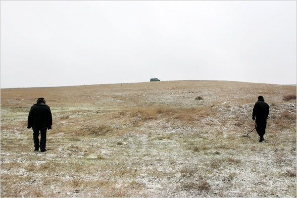 """A policy of one bullet for one person left some to be buried alive and cause the ground to shift. The research team directed by Father Desbois used metal detectors to find bullets and cartridges, which help locate the graves.   Photo: Guillaume Ribot/Yahad-In Unum. """"A Priest Methodically Reveals Ukrainian Jews' Fate""""."""