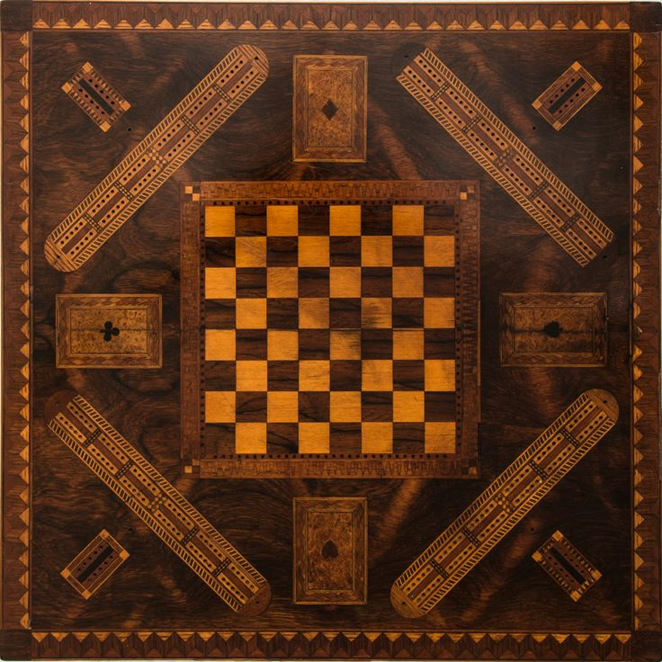 """Victorian Renaissance Revival marquetry inlaid game table featuring a chess and cribbage gameboard on the top of the table. The legs are incised with, drop finials, scrolled feet and with a relief carved pedestal column. Burlwood, Ebony, Mahogany, Maple and Pine. American, c.1870-1890 27"""" x 21 ½"""" x 21 ¼"""" ."""