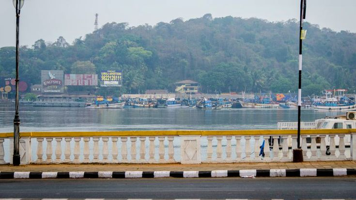 Crossing the Mandovi River at Panjim, heading across the large river estuary, with super views of the river's jungly banks upstream and the tourist boats downstream.