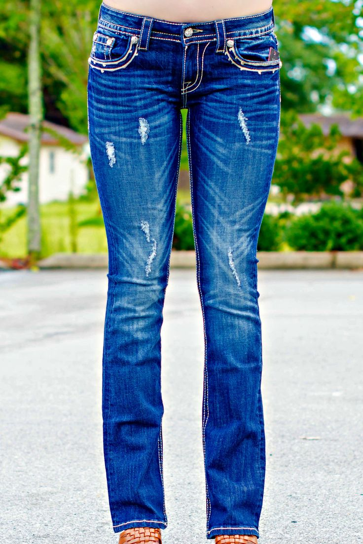 """We love these boot-cut Miss Me jeans! Our model is 5'9"""". Designed in U.S.A. 98% Cotton 2% Elastane"""