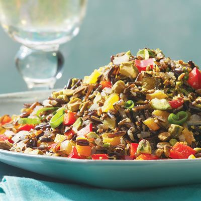 Love how colorful this dish is.  Wild Rice with Dried Apricots and Pistachios.
