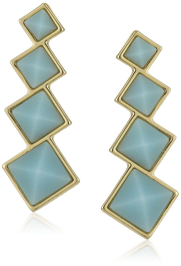 Rebecca Minkoff Stone Climber Earrings. Made in China. Gold plated climber earring with squares and blue stones. Store in protective pouch, do not wear in water. Designed in New York, Made in China. Imported.