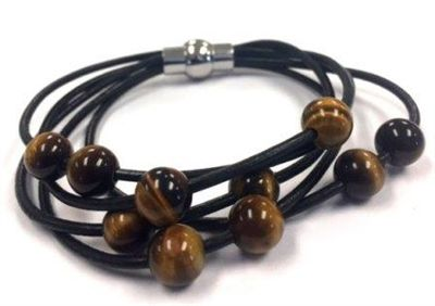 For skinny wrists. Black leather bracelet that has six strands of 2mm leather cords accented with ten 8mm moveable tigers eye beads