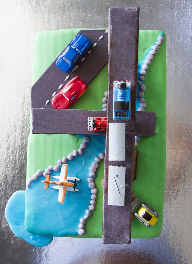 4th birthday cake, you can see the 4 from the top view :) Mr 4 wanted a Thomas the Tank Engine, Disney Cars and Disney Planes (3 tiers and moving - ummmmm not this time!