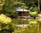 House : a nice house and boathouse on a placid lake Stock Photo