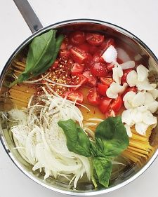 Place dried pasta in a skillet with water, tomatoes, onion, garlic, herbs, and a glug of olive oil, then cook everything together. Once the water has boiled away, you are left with perfectly al dente pasta in a creamy sauce that coats every strand.