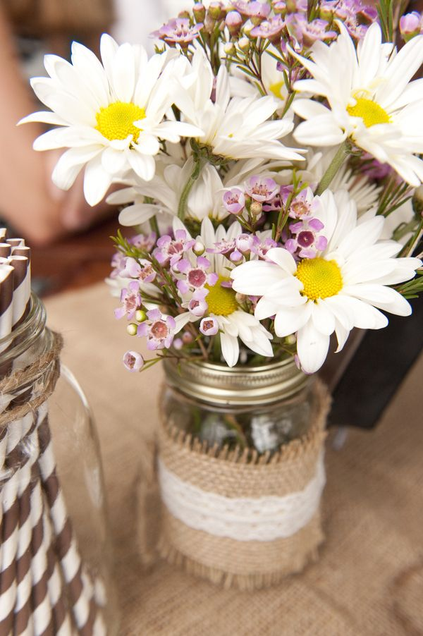 Wildflowers in a burlap-and-lace-wrapped jar