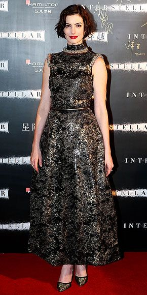 Last Night's Look: Love It or Leave It? | ANNE HATHAWAY  | The Oscar winner keeps her starry theme going in a subtly gilded Chanel Couture for the Interstellar premiere in Shanghai, China.