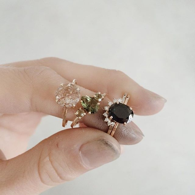 Late night ✨ Left to right: rutilated Quartz in yellow gold, pear trio with Moldavite in Rose gold, deep blue oval Australian sapphire in Rose gold with diamond crown ✨  Rings   @nataliemariejewellery