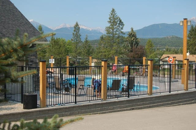 Seasonal swimming pool and lounging area with awesome views of Steamboat Mtn and the Purcell Mountain range.
