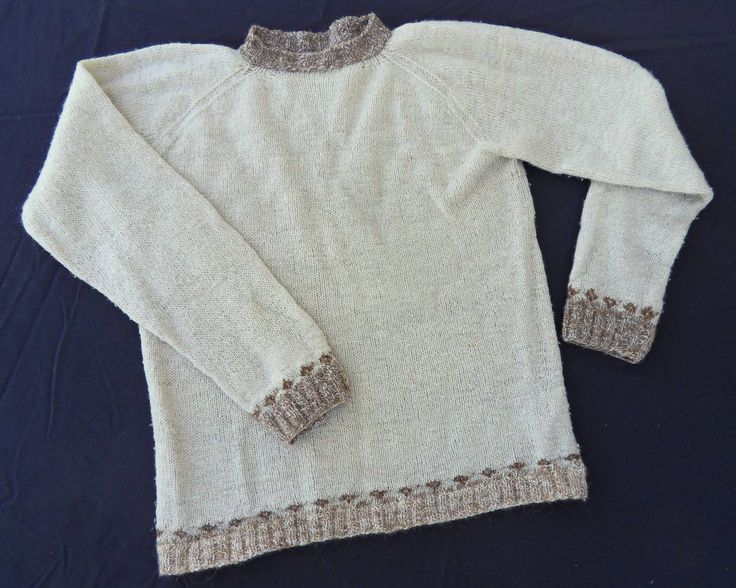 Sweater with white Finn sheep wool, collar and cuffs brown wool from Hälsingland, Sweden.