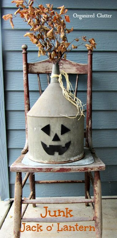 A Funnel Jack o'Lantern {cut shapes out of black foam, adhere with double stick tape}