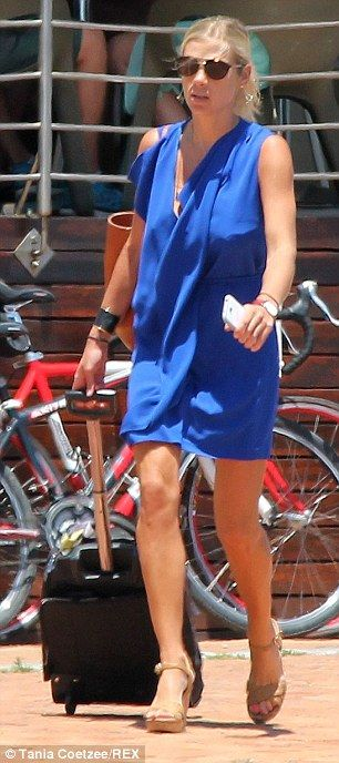 Chelsy Davy wore a cobalt dress in accordance with the blue and white dress code at the pr...
