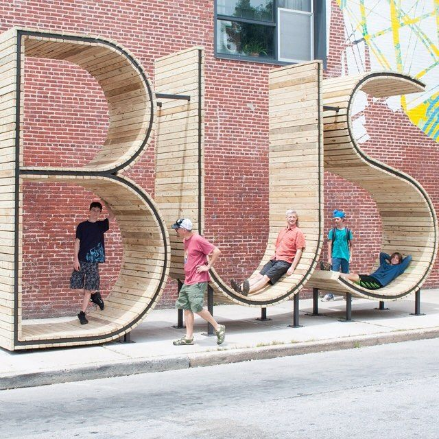 situated in heart of baltimore, spanish artist collective #mmmm… created a 14 foot tall permanent public art project and bus stop that includes three large sculptures forming the letters BUS in 2014.  #designboom #publicart