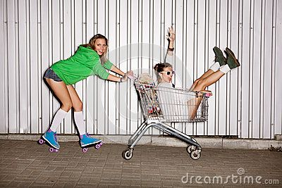 stock photo happy naughty women with shopping cart outdoors