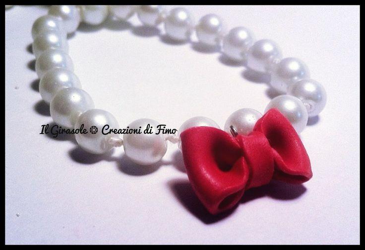 Bracciale elastico con perle e fiocco rosso in fimo, by Il Girasole ❂ Creazioni di Fimo, 7,00€ su misshobby.com