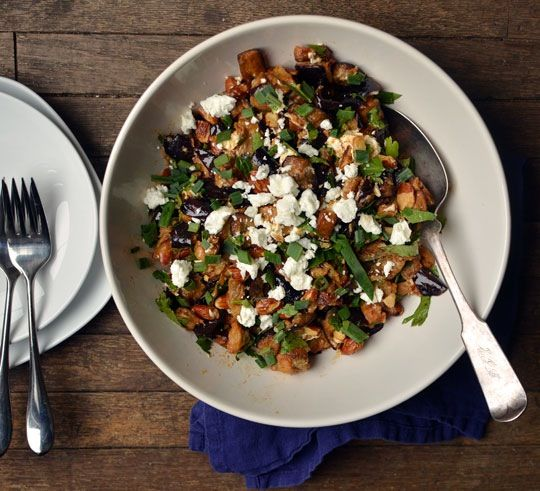 I have a confession to make: I have a hard time considering eggplant a summer vegetable. I know that it grows in the sunshine, right in between the tomatoes and the basil, but its silky, melting texture is what I want in wintertime. It's light yet satisfying, the perfect comfort food for January. Some people guiltily buy avocados in winter; others, pineapple. Me, I buy eggplant. And when I do, I make this salad.
