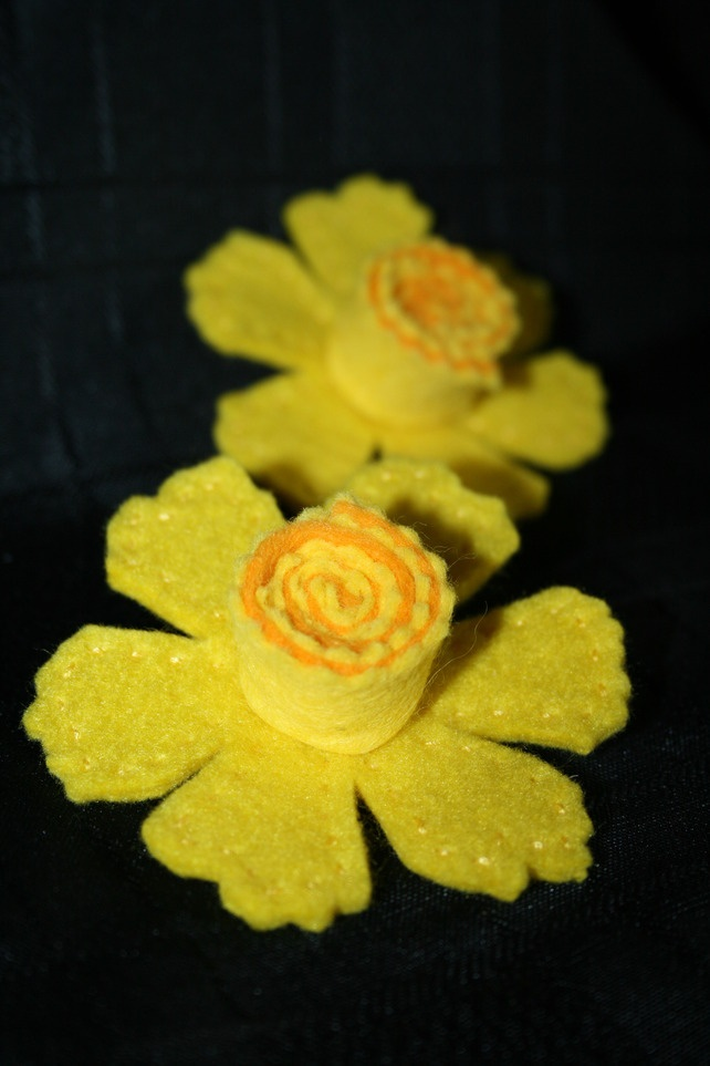 Felt Daffodil. Easy to make! So cute on your baby girl's head! No hair, clips or bands necessary! Girlie Glue can hold it onto the skin on hair all day! All natural. girlieglue.com