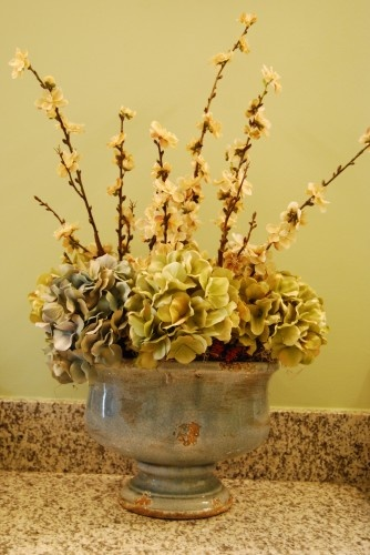 Custom Floral Arrangement in a master bathroom help bring all elements of the room together.  A.HICKMAN Design