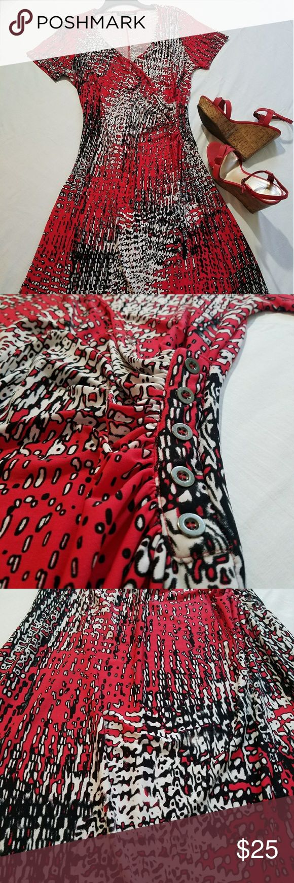 "Mlle Gabrielle dress SZL Red, black and white print faux wrap dress by Mlle Gabrielle. Comfy and cute dress to wear for work or weekend play. The dress has gathered side with faux buttons. Short sleeve. Very stretchy. Knee length. Measurements are 42"" from shoulder to hem. Worn a few times and still in great condition. Mlle Gabrielle  Dresses"