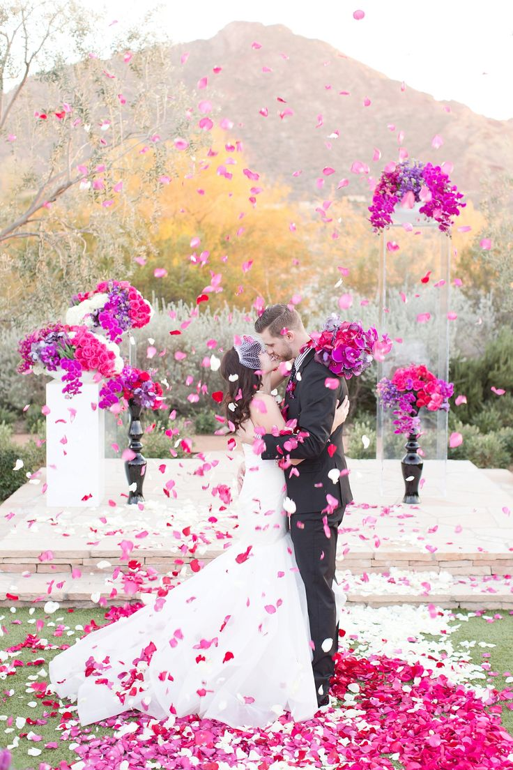 Stunning bright, bold, and colorful El Chorro wedding! Vibrant pinks, fuchsia, and purple orchids. And the color scheme was accented with and geometric shapes and patterns throughout! Modern petal runner with bold shapes and colors.