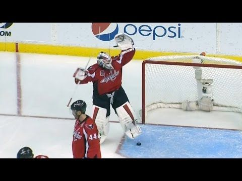 Hockey puck disappears in Holtby's equipment - YouTube