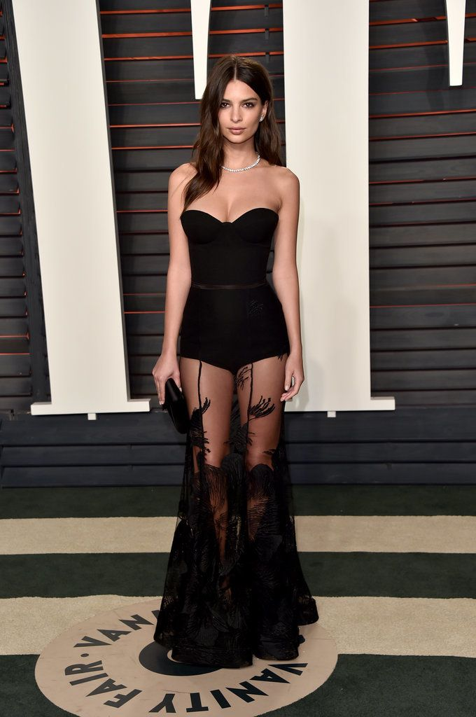 Emily Ratajkowski Wearing a Steven Khalil dress, Brian Atwood heels, Neil Lane jewels, and a Tyler Alexandra clutch at Vanity Fair's Oscar party.