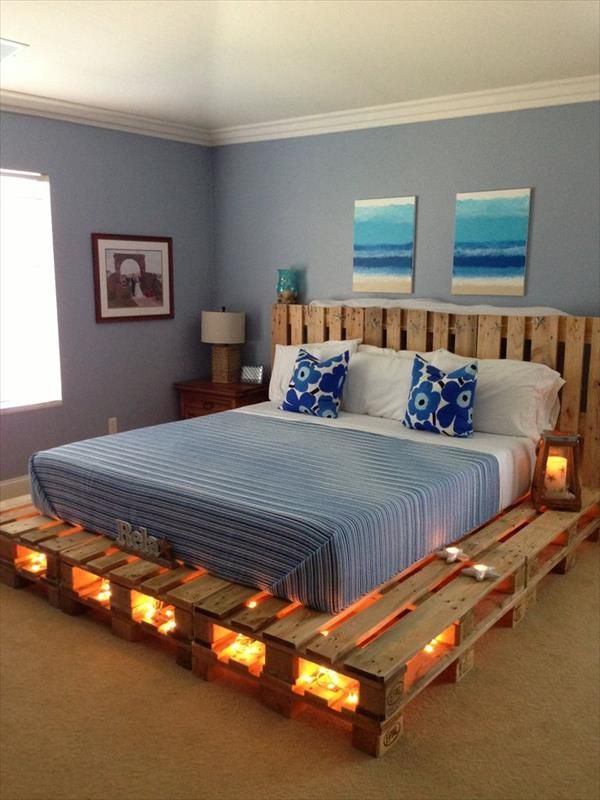 Pallet bed design with string lights [kind of beachy-teenager. reminds me of my college days. jh]
