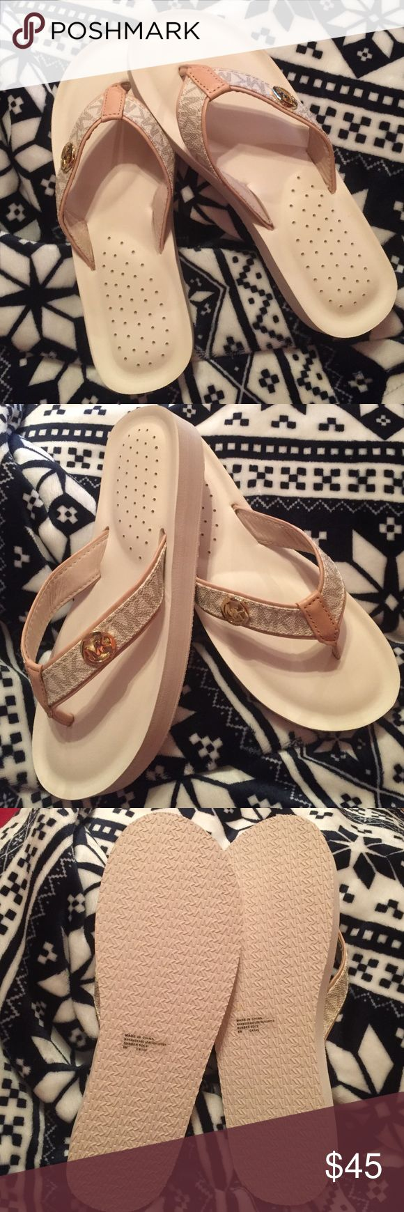 Michael Kors flip flops Nice cream color new only missing 📦 newer use Michael Kors Shoes Slippers