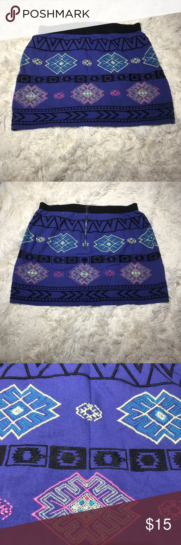 AMERICAN EAGLE OUTFITTERS mini skirt American Eagle Outfitters Aztec Mini Skirt.  Has elastic waist with zipper on the back.  Size 8. Purple with pink,blue,black and yellow design.  EUC.  Approx measurements waist 15, length 15.  Loc A147. American Eagle Outfitters Skirts Mini