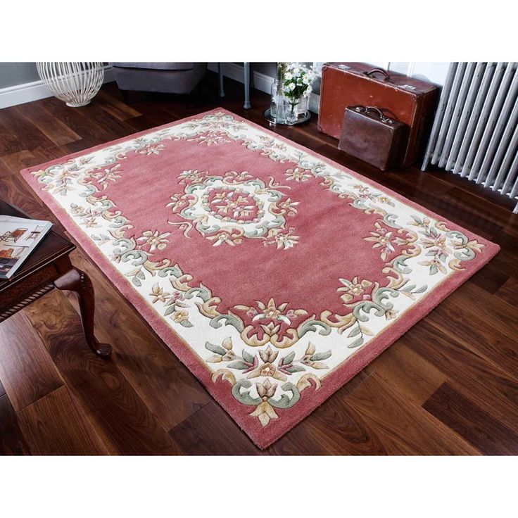 Royal Rose Traditional Rug By Oriental Weavers Dress up the look of any space with this handmade Oriental Royal Rose Traditional Wool Rug. The plush pile of this rug will provide comfort to your feet, while the strong canvas backing provides your rug with durability. #handmaderugs #borderedrugs #woolrugs #traditionalrugs #floralrugs