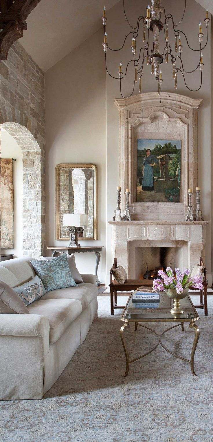 tuscan mediterranean living room chandelier fireplace
