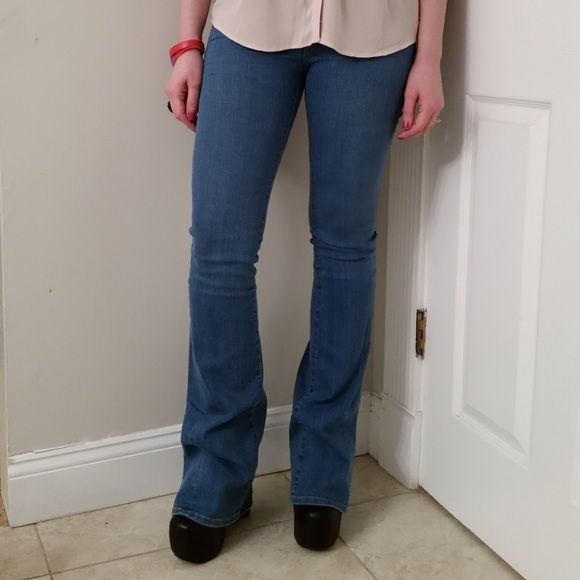 """Joie Mid Rise Flare Leg Jean These jeans are NWT! They are a light blue. Official color name is Aqueous. They are flare jeans and very long. They are approximately 13 1/2"""" across the waist when laid flat. They are 42"""" long with a 34"""" inseam. They are 90% cotton, 6% eme, 4% elastane. They are very comfortable and stretchy. These seem to fit true to size. Joie Jeans Flare & Wide Leg"""