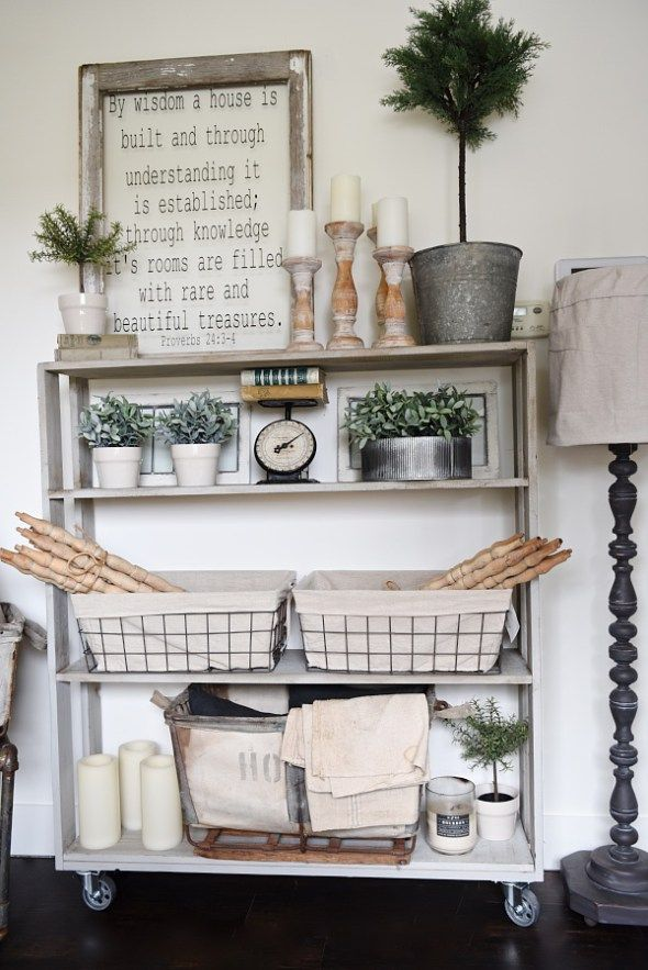 DIY rolling bookshelf - A vintage inspired DIY bookshelf that is so easy to build! With complete instructions on how to build your very own custom one. A great piece for living rooms, kitchens, dining rooms, media rooms, & so much more!