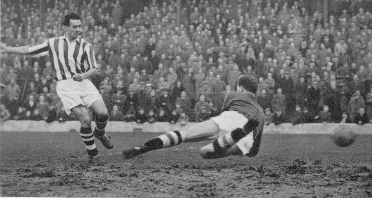 9th January 1957. West Bromwich Albion centre forward Ronnie Allen scoring past Doncaster Rovers goalkeeper Harry Grieg, in an FA Cup 3rd Round Replay.