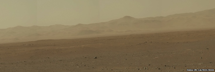 Nasa has released the first full colour mosaic from its Curiosity rover on the surface of Mars.    Scientists have remarked that the rover's surroundings resembled parts of the southwestern US.    Curiosity's ultimate goal is to drive towards a peak - informally known as Mount Sharp - to study its rocks.    Shown in the mosaic is a section on the crater wall where a network of valleys are believed to have formed through water entering from the outside.