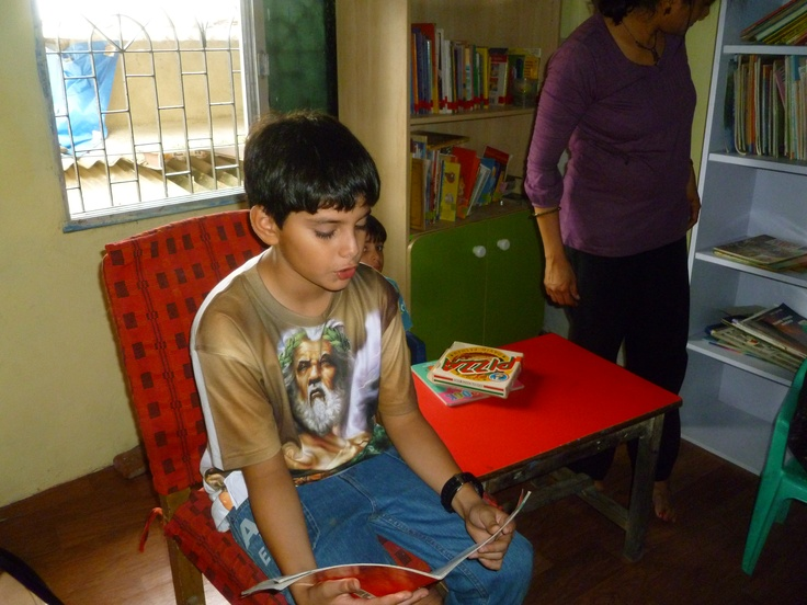 A reading session lead by a Bookwallah volunteer's 12 year old son at HBT Orphanage - Mumbai, India