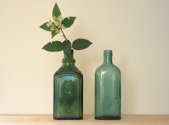 2 Beautiful & Rare Embossed Green Glass Bottles. by PrettiePlease, €25.00