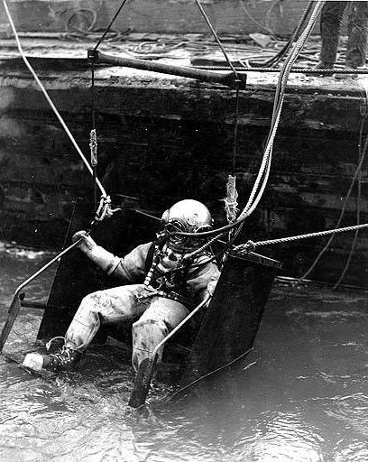 Diver entering water at the Grand Coulee Dam construction site on January 7, 1938.