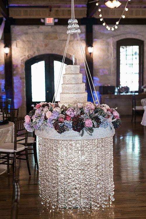 A Wedding Planners Rustic, Romantic Texas Wedding, Hanging Cake Display | Brides.com