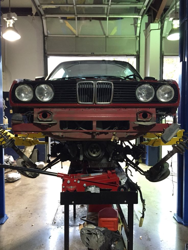 Little brother's rebuild. I bought him his dream car: a 1986 BMW E30 325e two years ago for $500 and today, he put in a brand new engine. Proud of you little man!