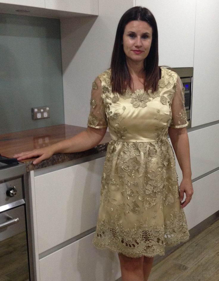 Nardia's Gold Lace Dress