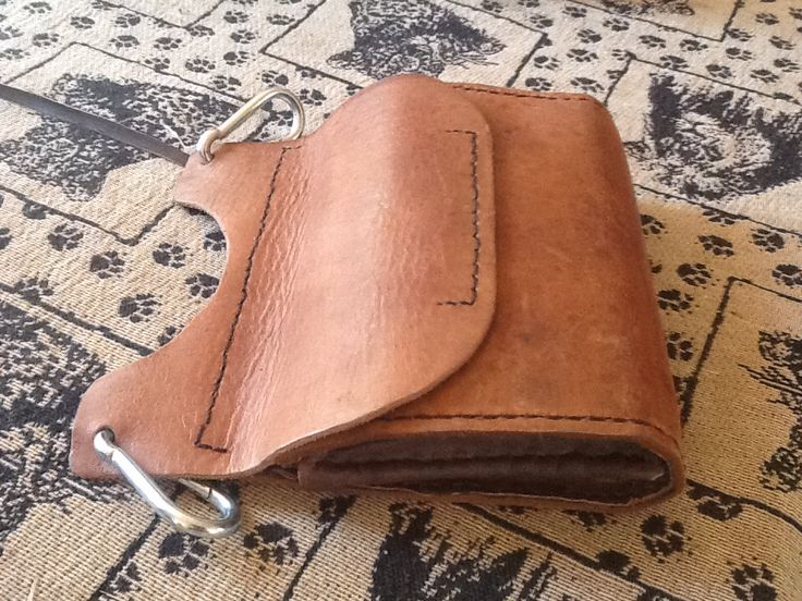 Leather side pouch hand stiched. Mini man bag that hangs from the belt.