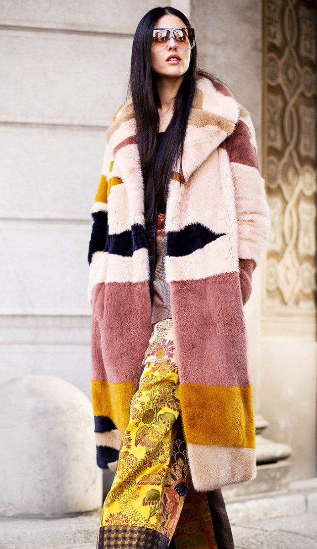 A colorful coat pairs well with printed silk trousers