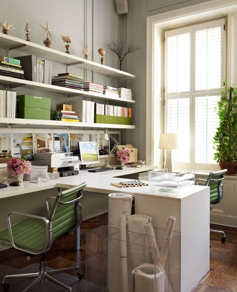 beautiful white & green modern office design with gray walls paint color, white desks, green eames aluminum chairs and white floating shelves.
